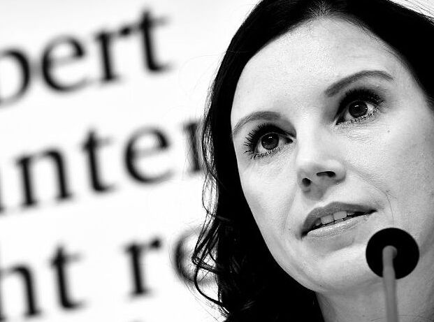 "HANOVER, GERMANY - OCTOBER 10: (EDITOR'S NOTE: This image has been converted from color to black and white) Teresa Enke, wife of former German national goalkeeper Robert Enke (not pictured), presents the ""EnkeApp"" during a press conference at HDI-Arena on October 10, 2016 in Hanover, Germany. Robert Enke committed suicide on November 10, 2009, following severe depression. Teresa Enke initiated the ""Robert-Enke-Stiftung"" to fight against depressions inside professional sports and today launched the app for smartphones. (Photo by Alexander Koerner/Bongarts/Getty Images)"